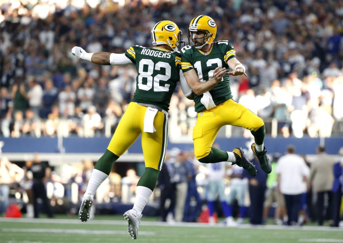 Green Bay Packers Tight End Richard Rodgers 82 And Quarterback Aaron 12 Celebrate A Touchdown In The Final Seconds Of Second Half Their
