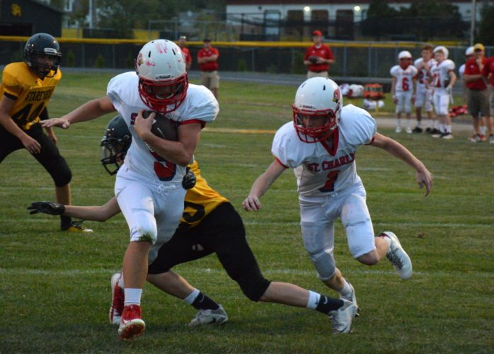 St. Charles running back Joe Eddy, left, rushes for a touchdown against South Adams on Oct. 3 in Berne. Teammate Henry O'Keefe is at right. (Photo by Reggie Hayes of The News-Sentinel)