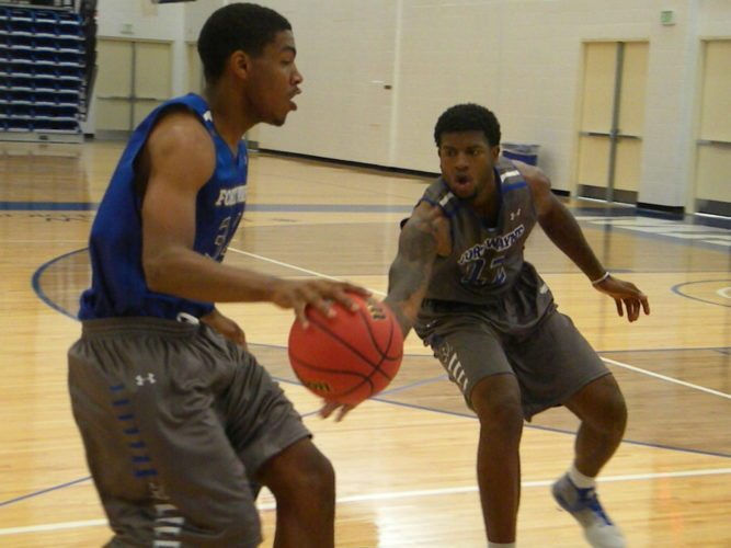 Fort Wayne fifth-year center Xzavier Taylor, right, defends against freshman Cameron Benford during a recent practice at the Gates Sports Center. (By Tom Davis of The News-Sentinel)