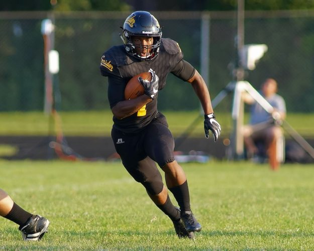 Snider's Christian Covington heads  upfield during a game against  Carroll. (By Gary Hale for The  News-Sentinel)