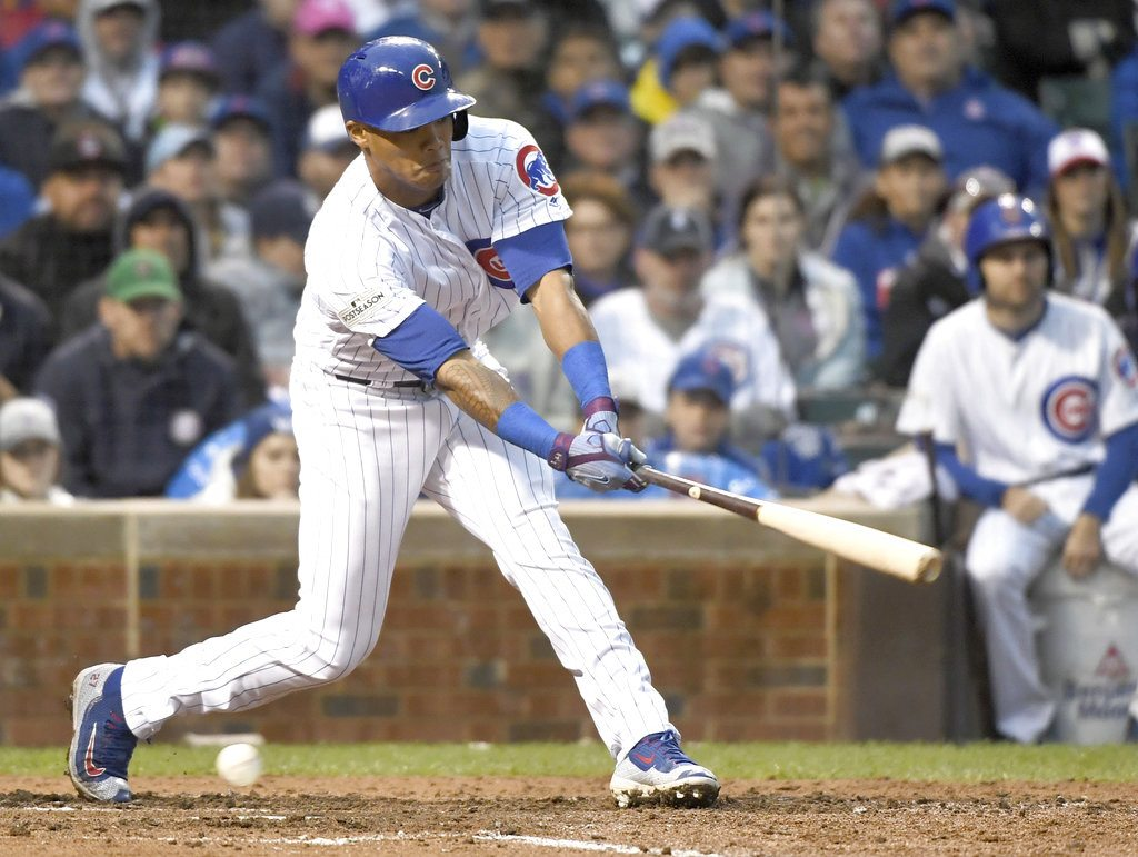 Addison Russell strikes out in the fourth inning against the Washington Nationals in Game 4 of the National League Division Series at Wrigley Field on Wednesday. The Cubs and Nats will meet in a deciding Game 5 tonight. (From The Associated Press