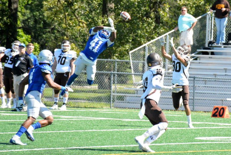 Saint Francis cornerback Willy Cole, center, breaks up a pass against Saint Francis of Illinois on Sept. 9 at Bishop D'Arcy Stadium. (Photo by Reggie Hayes of news-sentinel.com)
