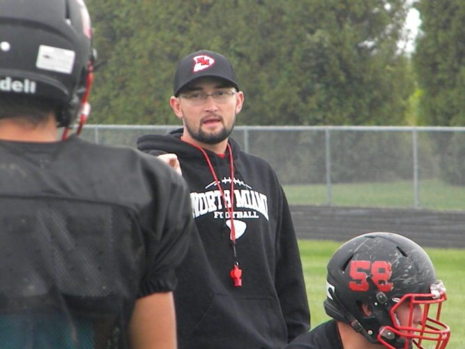 North Miami High School football coach Joe Grant instructs his players during practice Thursday in Denver. (By Tom Davis of News-Sentinel.com)