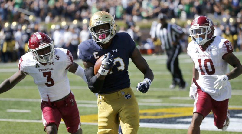Notre Dame running back Josh Adams (33) sprints to the end zone for a touchdown past Temple defensive back Sean Chandler (3) and Mike Jones (10) during the first half of a game last month in South Bend. (By The Associated Press)