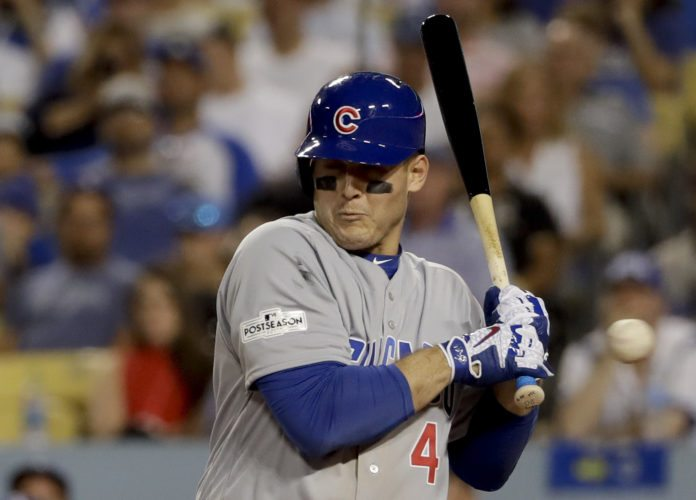 Chicago Cubs' Anthony Rizzo reacts after getting hit by a pitch during the ninth inning of Game 2 of baseball's National League Championship Series against the Los Angeles Dodgers in Los Angeles, Sunday. (Photo by The Associated Press)
