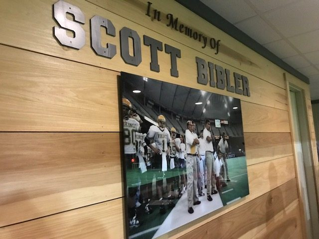 "A photo hangs on the back wall of a recently constructed press box at Tippecanoe Valley High School in honor of former and fallen Viking coach Scott Bibler. Bibler nad his coach at Valley, Charlie Smith, both passed away in a plane crash in October of 2015. The school recently and officially renamed the as ""Smith-Bibler Memorial Field Home of Death Valley Football."" The fundig for the press box was provided by Bibler's widow, Stephanie. (By Tom Davis of News-Sentinel.com)"