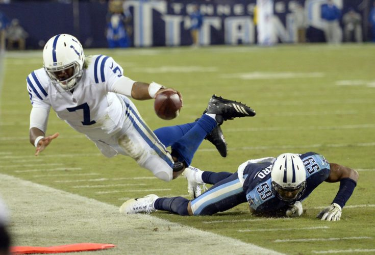Tennessee Titans inside linebacker Wesley Woodyard (59) knocks Indianapolis Colts quarterback Jacoby Brissett (7) out of bounds to stop a Colts' drive late in the fourth quarter of an NFL football game Monday, Oct. 16, 2017, in Nashville, Tenn. (AP Photo/Mark Zaleski)