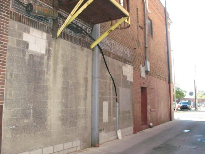 This alley at 927 S. Harrison St. will get a $7,000 facelift to cover the cinder block and painted brick, but the natural brick won't be covered. (Photo by Kevin Leininger of The News-Sentinel)