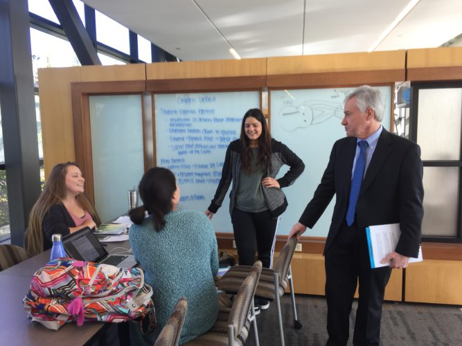 Incoming IPFW chancellor, Ron Elsenbaumer, right, stops to talk to students Tuesday in Walb Student Union during a visit to the campus. He'll become chancellor Nov. 1. (Photo by Lisa M. Esquivel Long of The News-Sentinel)
