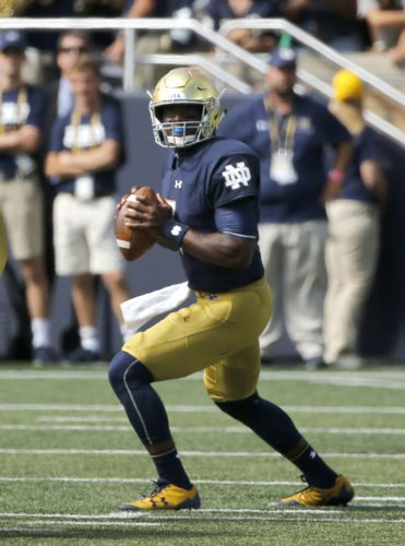Notre Dame quarterback Brandon Wimbush drops back to pass during the first half of a game against Temple last month in South Bend. (By The Associated Press)