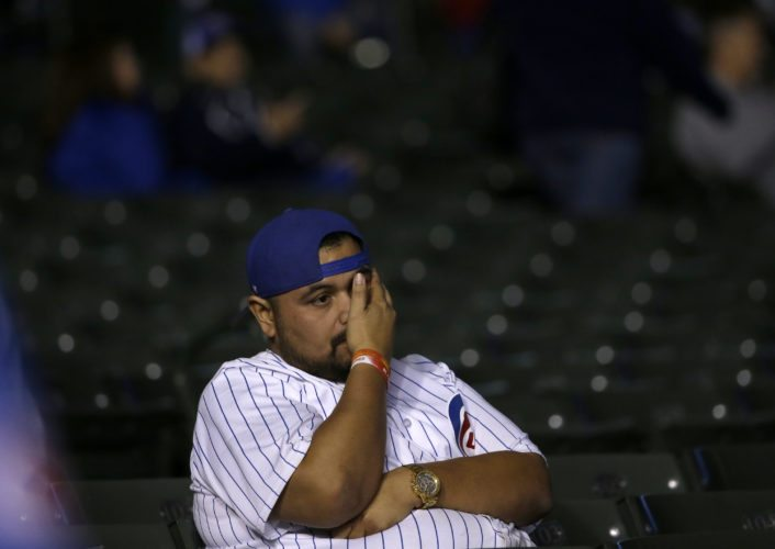 Chicago Cubs fan reacts after Game 3 of baseball's National League Championship Series against the Los Angeles Dodgers, Tuesday, Oct. 17, 2017, in Chicago. The Dodgers won 6-1. (Associated Press photo)