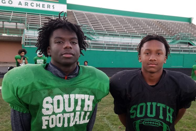 South Side basketball players Demarque Perkins, left, and Mikale Stevenson stepped off the basketball court to help the Archers in football. (Photo by Reggie Hayes of news-sentinel.com)