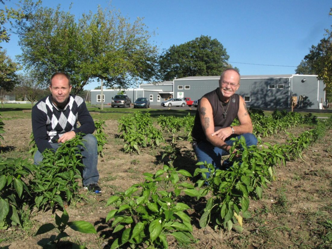 Hobson House Executive Director Greg Goetterman and Donnie Foster, house manager of the agency's new facility on Culbertson Street, inspect a garden that will supply produce for the drug treatment center's kitchen.