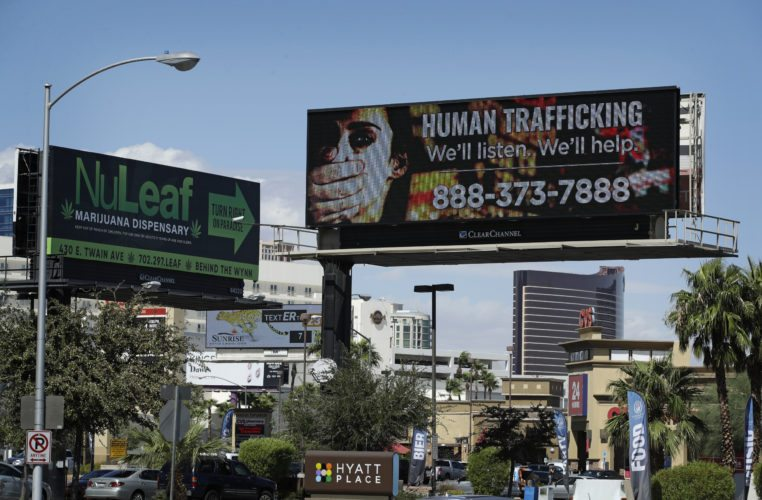 A billboard displays a phone number for the National Human Trafficking Hotline in Las Vegas.  (Associated Press file photo)