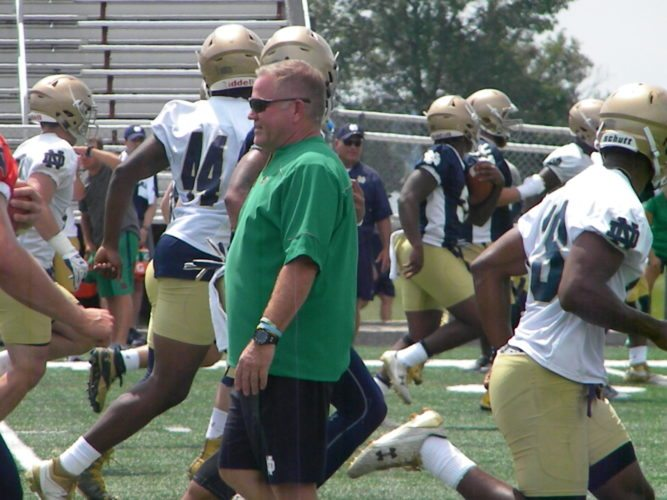 Notre Dame football coach Brian Kelly watches his team go through drills in training camp earlier this season at Culver Academy. (By Tom Davis of News-Sentinel.com)