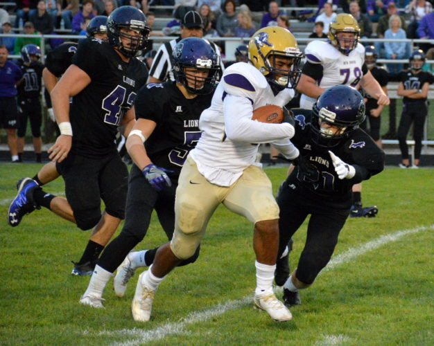 New Haven's Stephen Owens makes a run in the Bulldogs first meeting with Leo this season. The teams rematch in the opening week of Sectional play. (Photo by Reggie Hayes of The News-Sentinel)