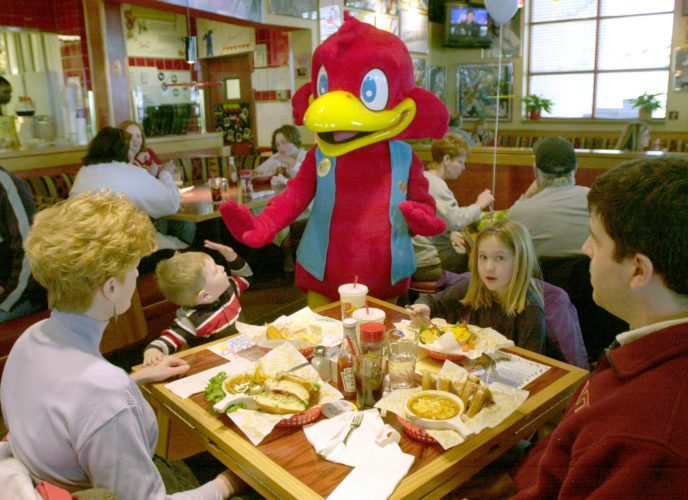 The Red Robin, center, gets a high five from  a younger diner at the Glenbrook Square restaurant.  (News-Sentinel file photo)