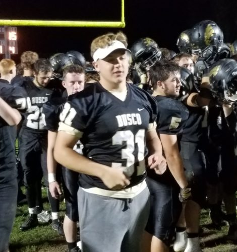 Injured Churubusco senior Garrett Horn celebrates with his teammates following Friday's 31-15 victory over Northfield in sectional play. (By Justin Kenny of The News-Sentinel)