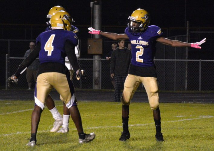 New Haven cornerback Zel Banks, right, reacts with teammate Kentrel Thomas after stopping a Leo pass on fourth down in New Haven's 20-7 win Friday at New Haven. (Photo by Reggie Hayes of news-sentinel.com)