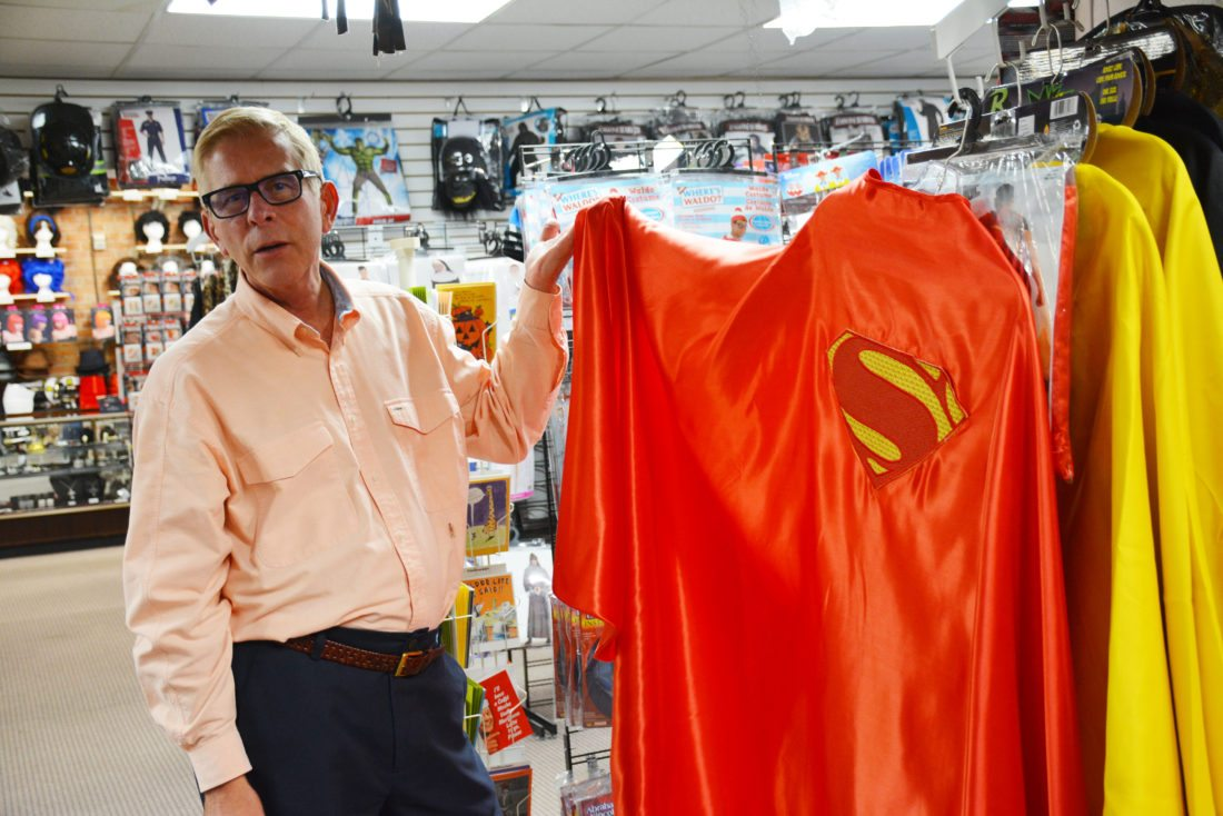 Kevin Stoner shows a Superman cape at Stoner's Funstore, 712 Harrison St. (Photo by Lisa M. Esquivel Long of The News-Sentinel)
