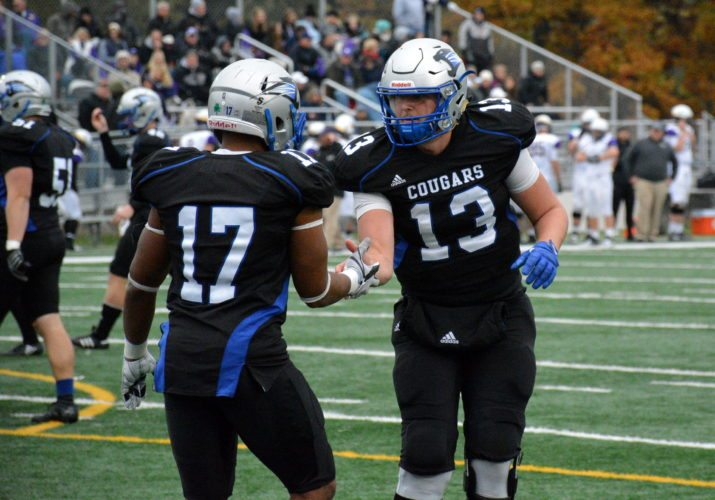Saint Francis quarterback Nick Ferrer, right, congratulates running back Justin Green after Green scored a touchdown in the Cougars' 40-20 win over Taylor on Nov. 4 at Bishop D'Arcy Stadium. (Photo by Reggie Hayes of news-sentinel.com)