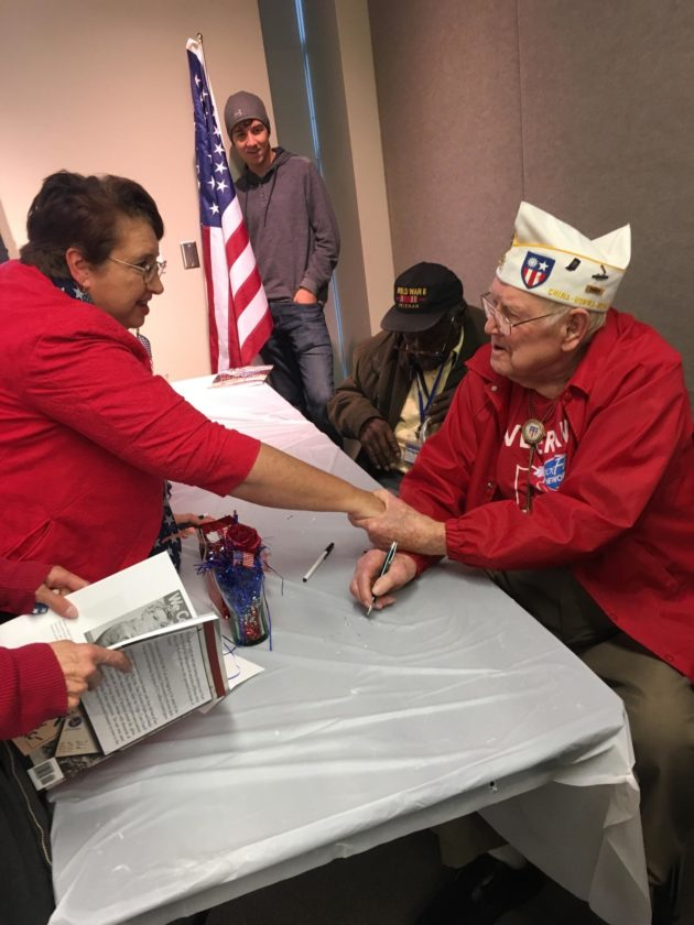 Wells County author Kayleen Reusser talks with World War II veteran Frank Garrison on Saturday at the Allen County Public Library. (Photo courtesy of Alice Hayes)