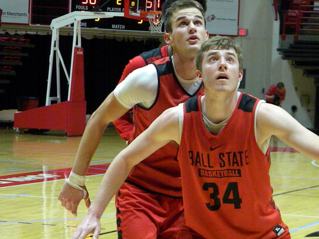 Ball State sophomore forward Kyle Mallers (background) battles for position with senior forward Sean Sellers during a drill in a recent practice at Worthen Arena in Muncie. (By Tom Davis of News-Sentinel.com)