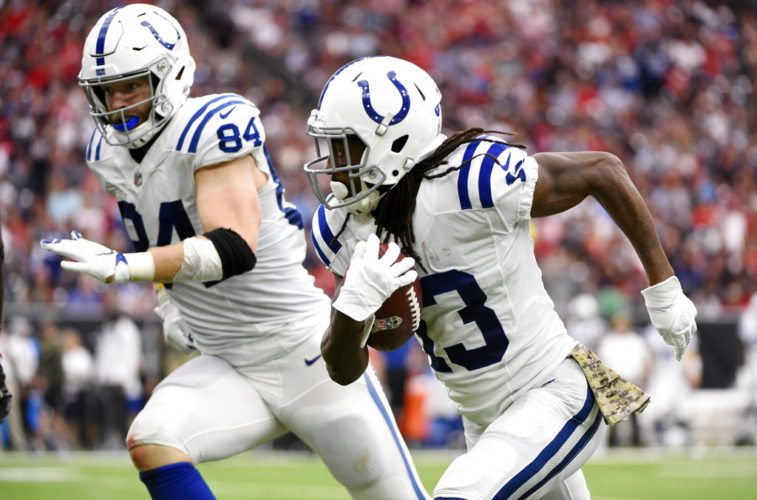 Indianapolis Colts wide receiver T.Y. Hilton (13) runs for an 80-yard touchdown following a catch during last Sunday's win at Houston. (From The Associated Press)