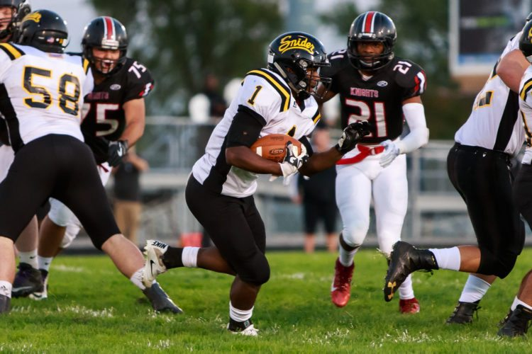 Snider running back Christian Covington  runs for yardage against Bishop Luers in the regular-season finale. Snider takes on Carmel in the regional championship game at 7:30 p.m. Friday at Spuller Stadium. (Photo by Josh Gales for News-Sentinel.com)