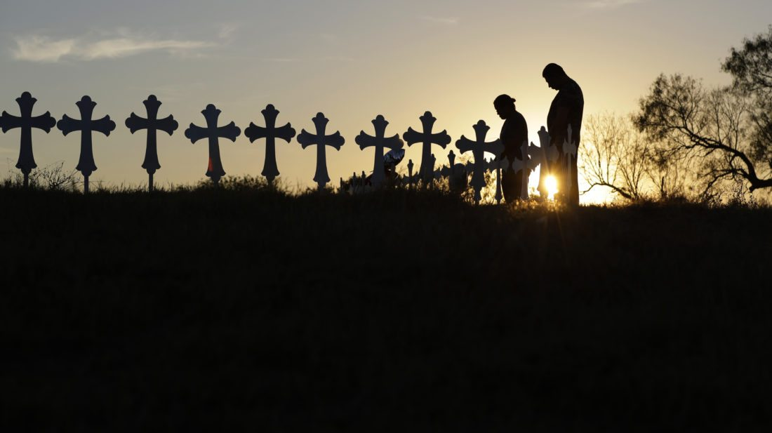 Mourners visit a makeshift memorial to the victims of the shootings at the First Baptist Church in Texas. But do we really need all those crosses? (By The Associated Press)