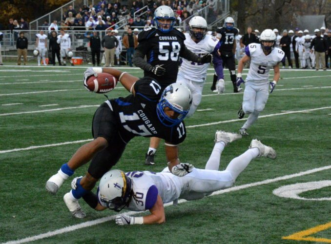 Justin Green keeps his balance while running against Taylor in Saint Francis' 40-20 win on Saturday at Bishop D'Arcy Stadium. (Photo by Reggie Hayes of News-Sentinel.com)