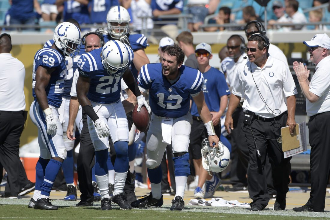 Indianapolis Colts cornerback Vontae Davis (21) is congratulated by quarterback Andrew Luck (12) after intercepting a pass intended for Jacksonville Jaguars wide receiver Allen Robinson during the second half of an NFL football game in Jacksonville, Fla., Sunday, Sept. 21, 2014.(File photo by the Associated Press)