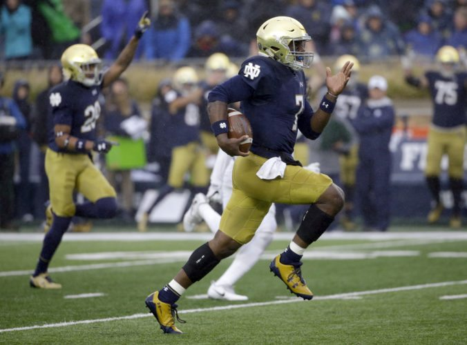Notre Dame quarterback Brandon Wimbush scores a touchdown by running during the first half of a recent game against Wake Forest in South Bend. (By The Associated Press)