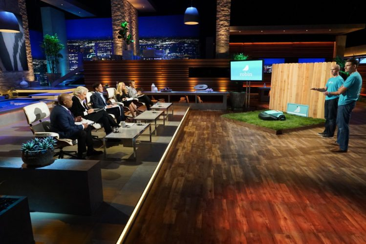 """The sharks of """"Shark Tank,"""" from left, Daymond John, Sir Richard Branson, Mark Cuban, Lori Greiner and Robert Herjavec, hear a pitch from Justin Crandall and Heritage High School graduate Bart Lomont on the duo's Robin Autopilot lawn mower. The show is scheduled to air at 9 p.m. Sunday locally on ABC affiliate, WPTA, Channel 21. (Photo courtesy of ABC)(Photo courtesy of ABC)"""