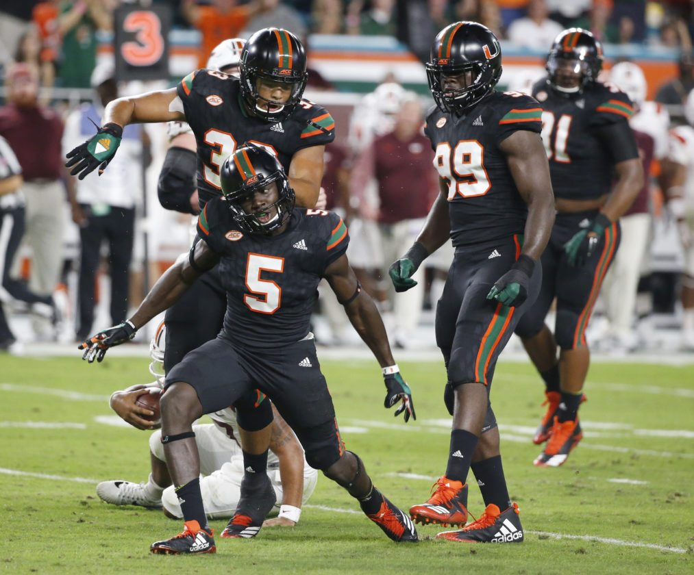 Miami defensive back Amari Carter (5) celebrates after sacking Virginia Tech quarterback Josh Jackson during the first half of a recent game in Miami Gardens, Fla. (By The Associated Press)