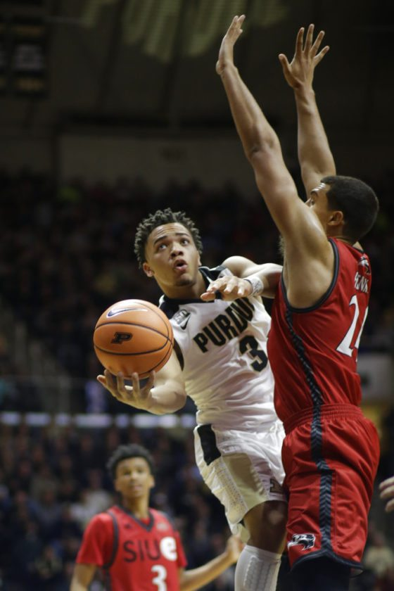 Purdue guard Carsen Edwards shoots around SIU-Edwardsville forward Jalen Henry during Friday's game at Mackey Arena. (By The Associated Press)