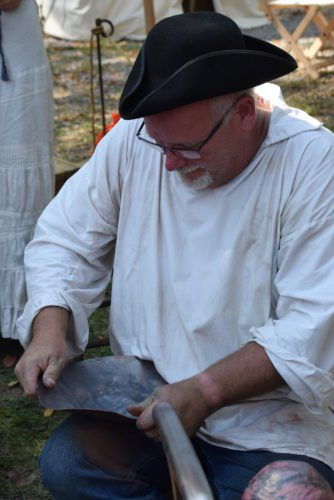 """John Motz works with metal Sept. 17 at the Johnny Appleseed Festival, which was filmed by """"CBS Sunday Morning."""" (File photo by Lisa M. Esquivel Long of news-sentinel.com)"""