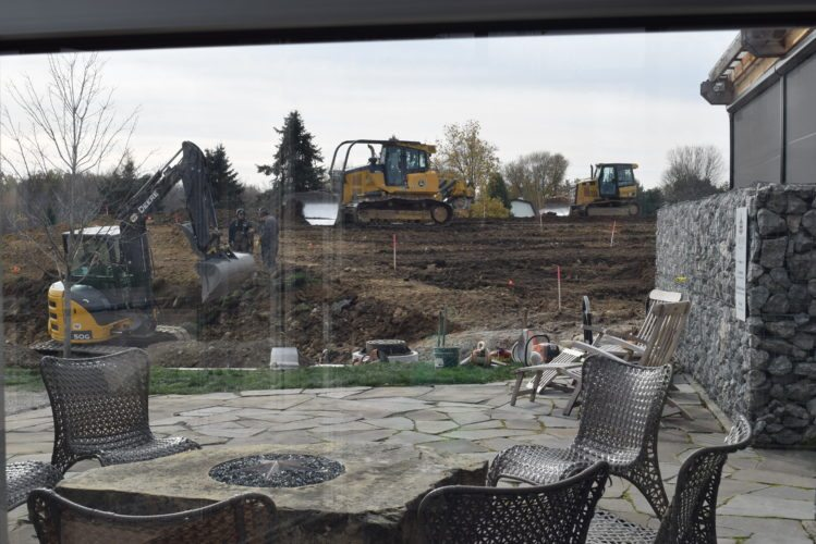 Construction, seen from inside Two-EE's Winery,  6808 U.S. 24, Huntington, takes place Saturday to create an amphitheater.  Co-owner Eric Harris says the work should be done by next summer's concert series and will include a spot for food trucks. (Photo by Lisa M. Esquivel Long of The News-Sentinel)