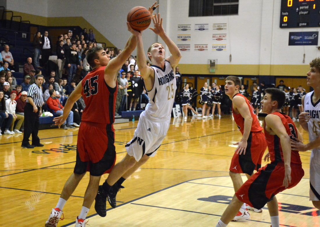 Norwell's Will Geiger, center, drives to the basket against Huntington North last season. (News-Sentinel.com file photo)