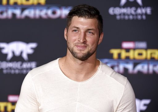 "Tim Tebow arrives at the world premiere of ""Thor: Ragnarok"" at the El Capitan Theatre on  Oct. 10 in Los Angeles. (Photo by the Associated Press)"