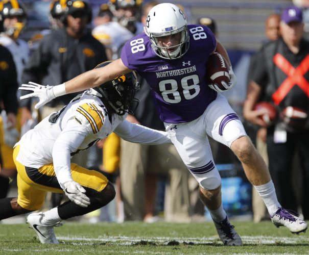 Northwestern's Bennett Skowronek, right, breaks away from Iowa's Joshua Jackson during the second half of an NCAA college football game Saturday, Oct. 21 in Evanston, Ill. (Photo by the Associated Press)