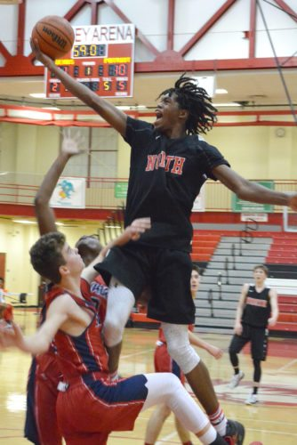 North Side junior Keion Brooks Jr. goes up for a layup in the Legends' scrimmage with Heritage on Thursday night. (Photo by Dan Vance of news-sentinel.com)