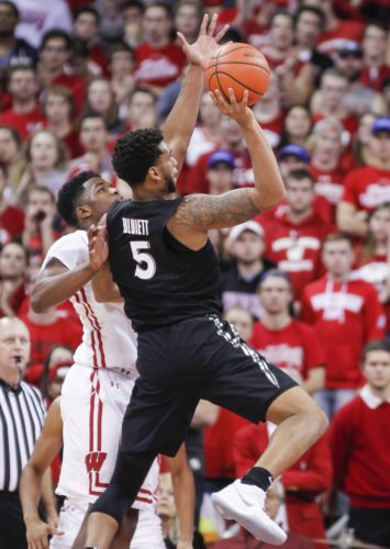 Xavier's Trevon Bluiett (5) shoots against Wisconsin's Khalil Iverson during the second half of a game Thursday in Madison, Wis. Xavier won 80-70. (By The Associated Press)