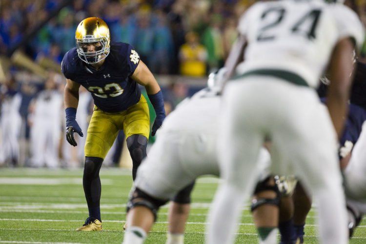 Notre Dame linebacker Drue Tranquill readies himself for a play against Michigan State earlier in his career at Notre Dame Stadium in South Bend. (News-Sentinel.com file photo)