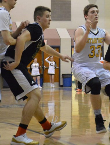 Churubusco's Brayton Bonar posts up during a Sectional game last season. (Photo by Justin Kenny of news-sentinel.com)