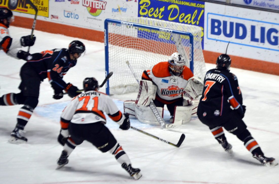 Kansas City's Mike McMurtry lifts a backhand into the top of the net in overtime to give the Mavericks a 4-3 win over the Komets on Friday night. (By Blake Sebring of News-Sentinel.com)