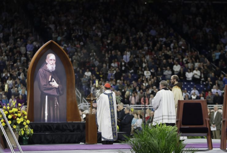 Cardinal Angelo Amato blesses a portrait of Father Solanus Casey during Mass at the beatification ceremony held Saturday at Ford Field in Detroit. Along with serving in ministry New York City and Detroit, Casey served from 1946 to 1956 at the former St. Felix Friary in Huntington. (AP Photo/Carlos Osorio)