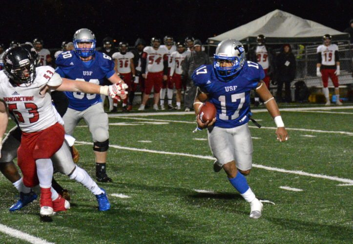 Saint Francis running back Justin Green, right, runs around the left end during the Cougars' win over Benedictine on Saturday at Bishop D'Arcy Stadium. (Photo by Reggie Hayes of News-Sentinel.com)