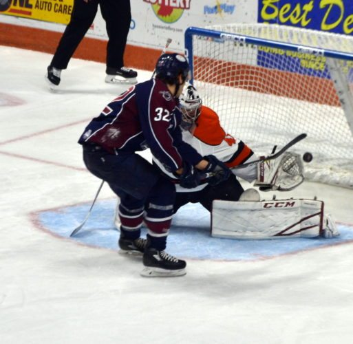 Komets goaltender Michael Houser stops a penalty shot by Tulsa's Kale Kessy late in the second period. (By Blake Sebring of News-Sentinel.com)