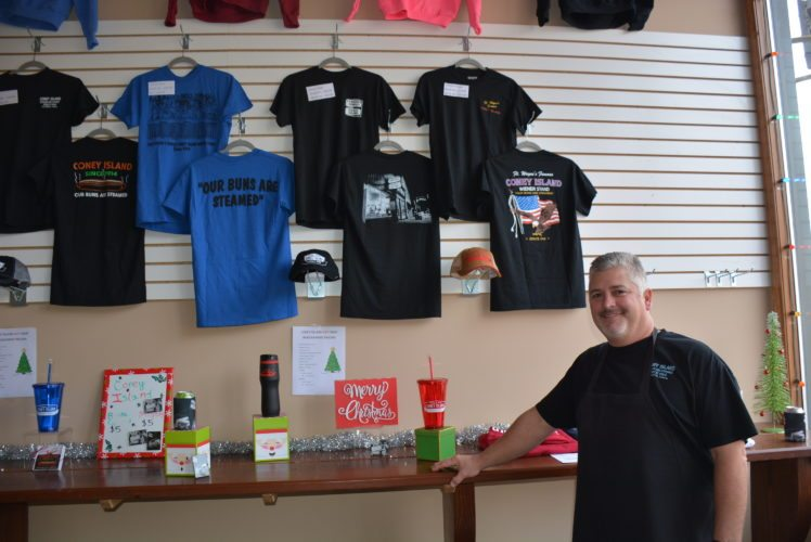 Jim Todoran, co-owner of Coney Island. stands in pop-up shop next to the restaurant, 131 W. Main St. (Photo by Lisa M. Esquivel Long of News-Sentinel.com)